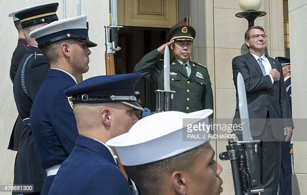 Chinese Gen Fan Changlong Vice Chairman of China's Central Military Commission and US Secretary of Defense Secretary Ashton Carter salute as their...