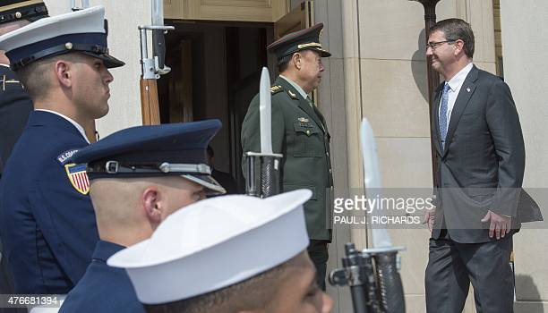 Chinese Gen Fan Changlong Vice Chairman of China's Central Military Commission and US Secretary of Defense Secretary Ashton Carter leave an arrival...