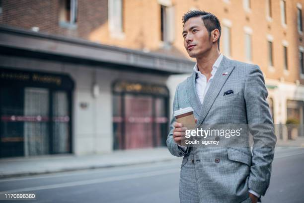 chinese gentleman in suit in city - gray suit stock pictures, royalty-free photos & images