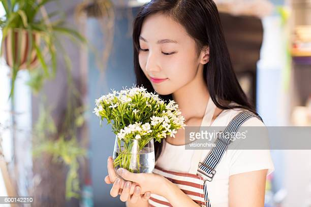 chinese girl and her beautiful flowers