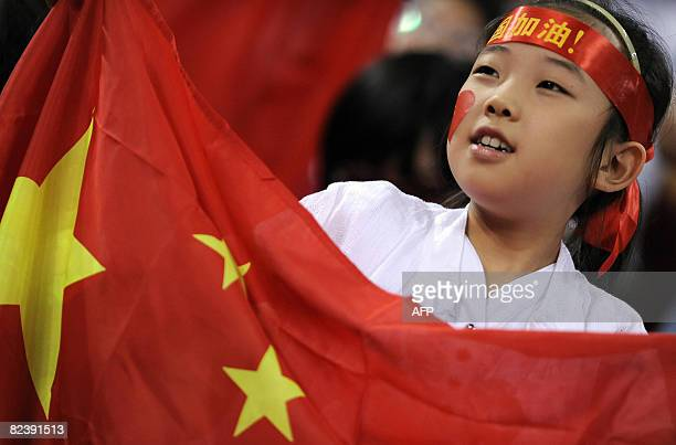 A chinese girl cheers during the women's preliminary round group B basketball match of the Beijing 2008 Olympic Games between China and Czeck...