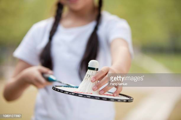 chinese girl holding badminton racket and shuttlecock - shuttlecock stock pictures, royalty-free photos & images