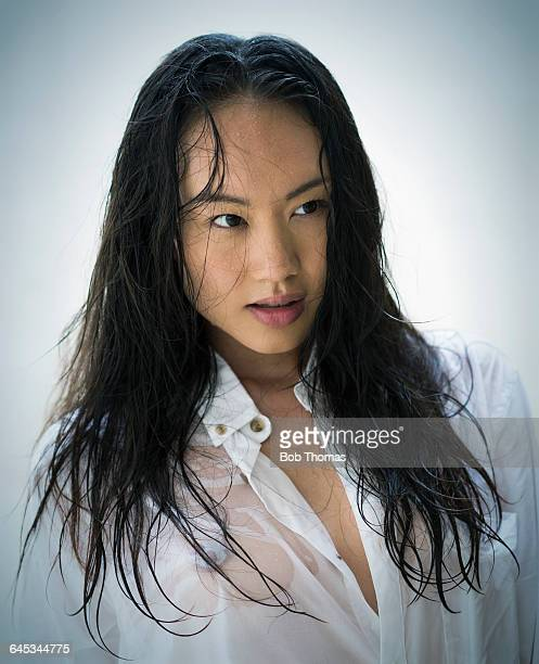 chinese girl in wet shirt - wet shirt stock photos and pictures