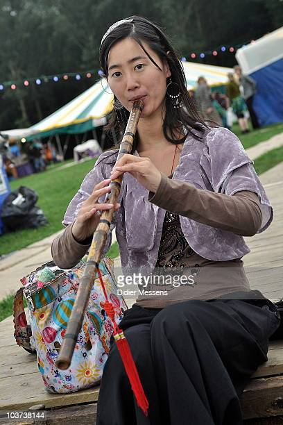 Chinese Girl playing bamboo flute during the second day of Boombalfestival on August 27 2010 in Lovendegem Belgium