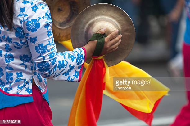 chinese girl playing cymbals - gwengoat stockfoto's en -beelden