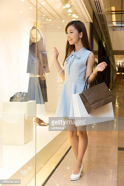 chinese girl shopping - fashion hong kong stock photos and pictures