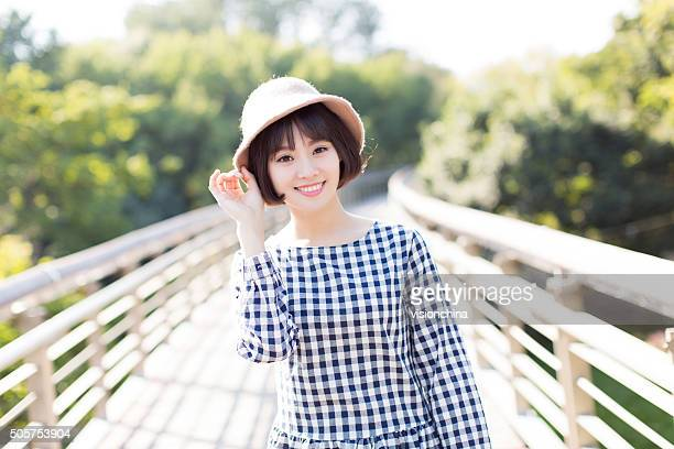 chinese girl with a sun hat