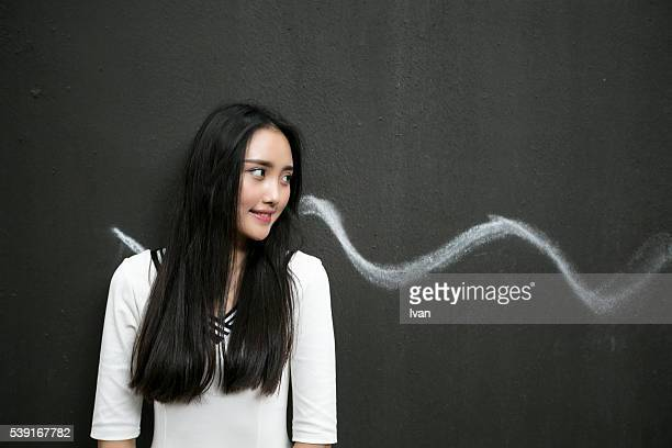 A Chinese Girl with Almond Eyes Looking Left With Black Background