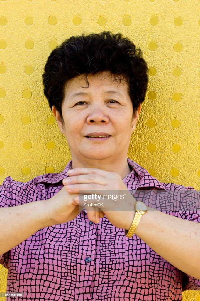 Chinese girl with cheongsam respecting : Stock Photo