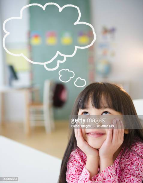 Chinese girl with thought bubble in classroom