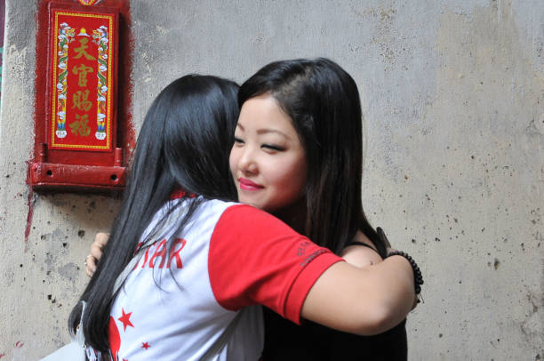 Chinese lunar new year celebrated in india a chinese girls celebrates as they welcome the chinese new year at the china town area voltagebd Gallery
