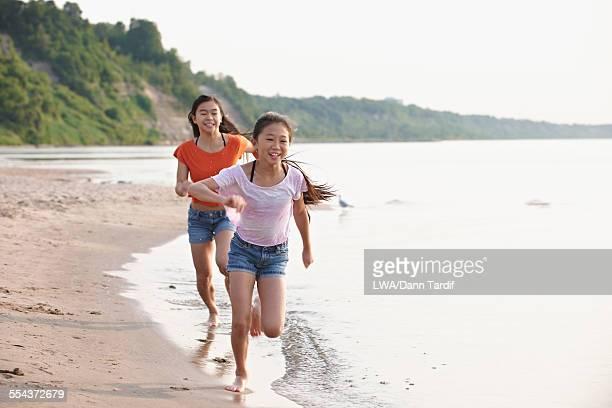 Chinese girls playing on beach