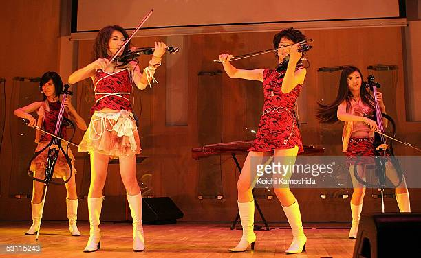 Chinese girls unit Musicat peform for their first time in Japan on June 22 2005 in Tokyo Japan The group consists of violists cellists Chinese harp...