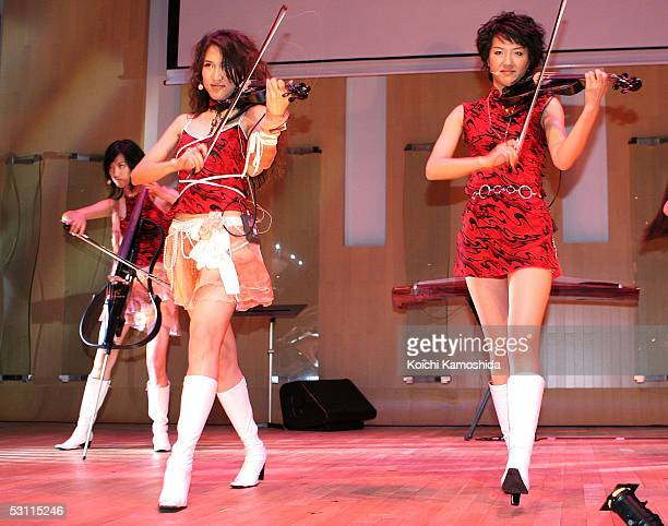 Chinese girls unit Musicat perform for their first time in Japan on June 22 2005 in Tokyo Japan The group consists of violists cellists Chinese harp...