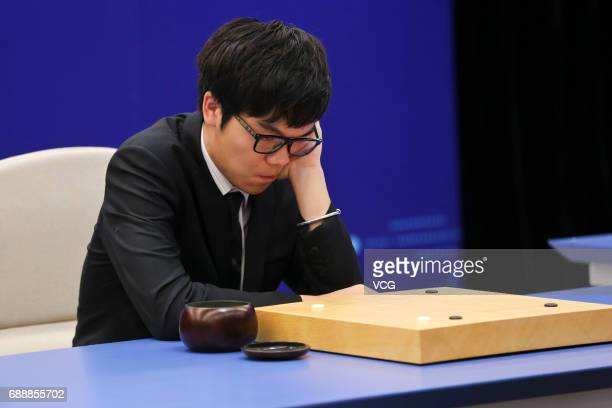 Chinese Go player Ke Jie competes against Google's artificial intelligence program AlphaGo at his third round game during the Future of Go Summit at...