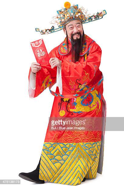 Chinese God of Wealth with red packet celebrating Chinese New Year