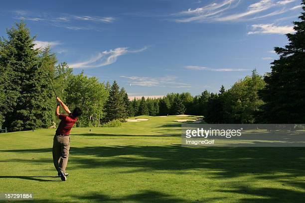 Chinese Golfer Hitting a Tee Shot