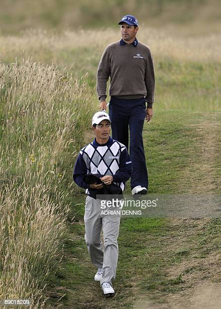 Chinese golfer Wen Chong Liang walks ahead of Republic of Ireland golfer Padraig Harrington during a practice round on July 14 2009 ahead of the...