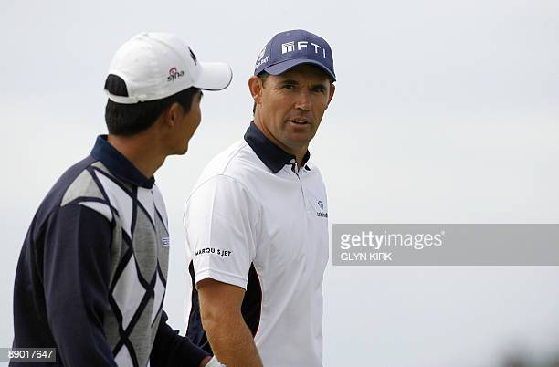 Chinese golfer Wen Chong Liang walks with Republic of Ireland golfer Padraig Harrington during a practice round on July 14 ahead of the 138th British...
