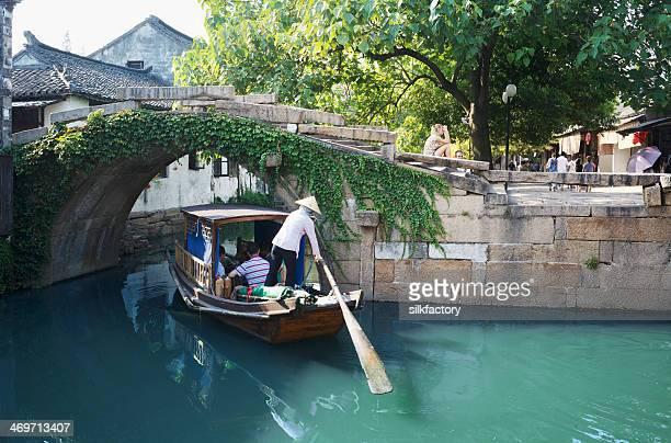Chinese gondola boat sightseeing trip under Twin Bridges in Zhouzhuang