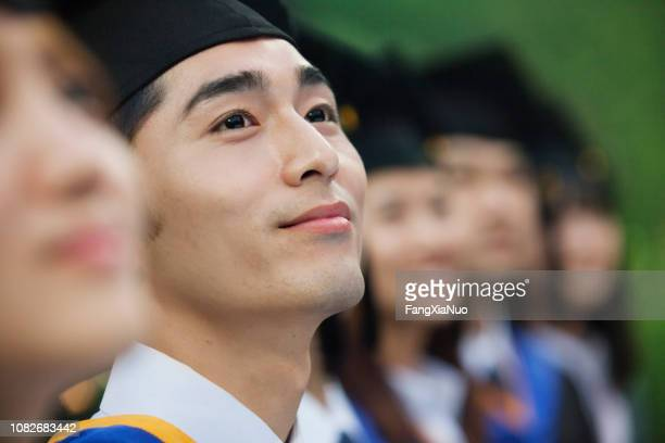 chinese graduates in caps and gowns - graduation clothing stock pictures, royalty-free photos & images