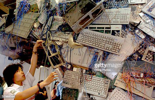 Chinese Greenpeace activists set up an Ewaste sculpture at the China International Hightech exhibition in an effort to shame the companies attending...