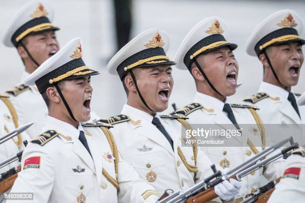 TOPSHOT Chinese guards of honour parade during the welcome ceremony of Singapore's Prime Minister Lee Hsien Loong at the Great Hall of the People in...