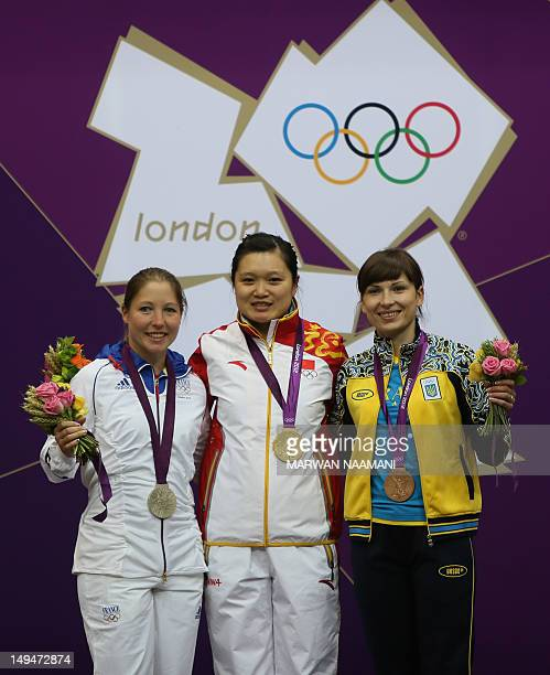 Chinese Guo Wenjun winner of the gold medal for the women's 10m Air Pistol at the London 2012 Olympic Games celebrates along with silver medalist...