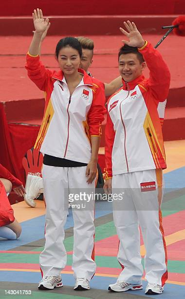Chinese gymnast Chen Yibing and retired diver Guo Jingjing attend a CocaCola ceremony to mark 100day countdown to London 2012 Olympic Games at...