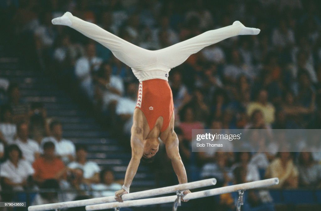 Chinese gymnast Li Ning pictured in action for China on the parallel bars during competition in the Men's individual all-around gymnastics event at the 1984 Summer Olympics inside the Pauley Pavilion in Los Angeles, United States in July 1984. Li Ning would go on to win a silver medal in the team all-around event at the 1984 Summer Olympics.