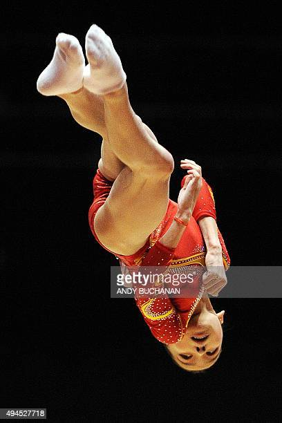 Chinese gymnast Shang Chungsong competes on the floor during the Women's Team event final on the fifth day of the 2015 World Gymnastics Championship...
