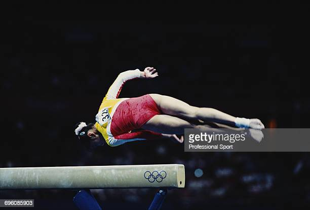 Chinese gymnast Yang Yun competes for China on the balance beam during competition in the Women's artistic team allaround event at the 2000 Summer...