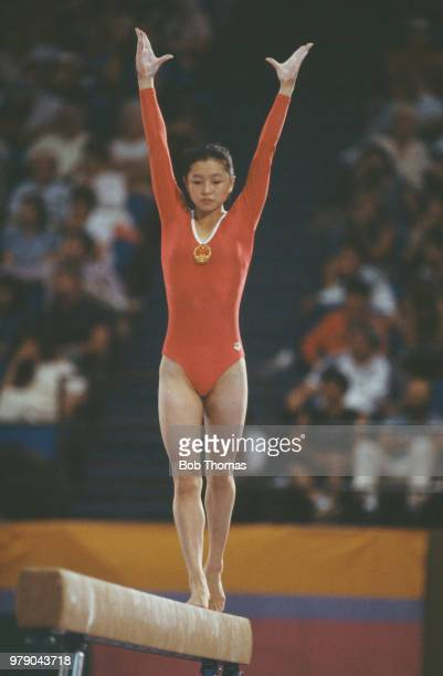 Chinese gymnast Zhou Ping pictured in action for China on the balance beam during competition in the Women's individual allaround gymnastics event at...