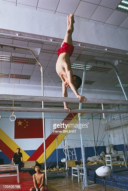 Chinese gymnastics school Horizontal bar This exercise bar is not as high as the one on which the gymnast was exercising earlier He remains a certain...