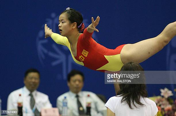 Chinese gymnasts Xing Le competes on the beam at the gymnastic events of the Special Olympics World Summer Games in Shanghai, 10 October 2007. A...