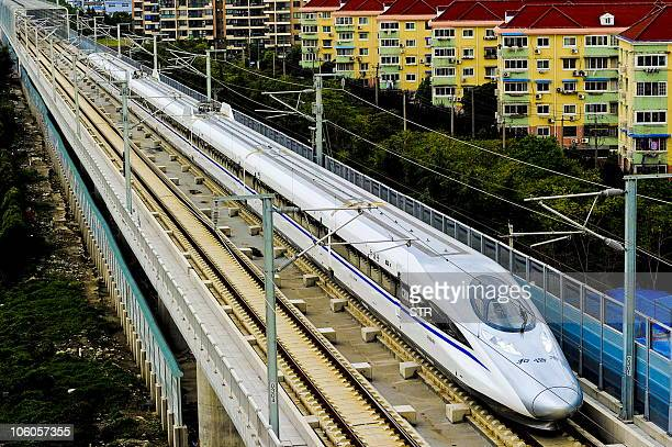 A Chinese highspeed train leaves the station in Shanghai on October 26 2010 after the launch of the Shanghai to Hangzhou line China's latest new...