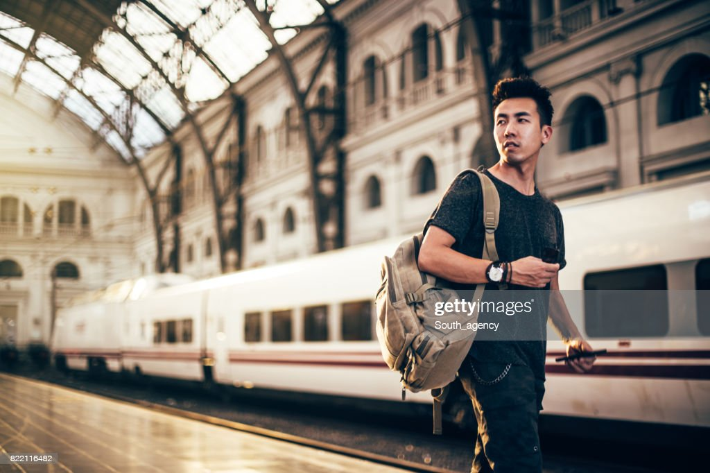 Chinese hipster man on a station : Stock Photo