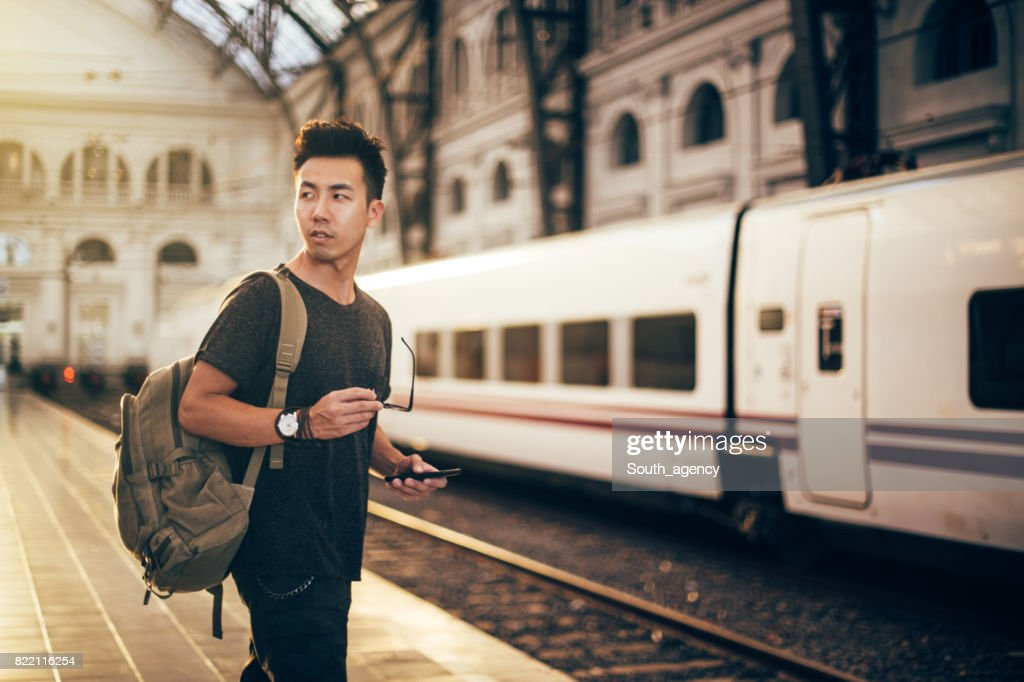 Chinese hipster man on a train station : Stock Photo