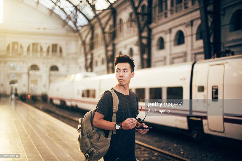 Chinese hipster man standing on station : Stock Photo