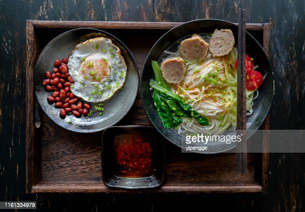 chinese homemade noodles with meatball and vegetables - noodles stock pictures, royalty-free photos & images