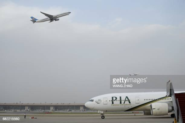 Chinese honour guard stands guard as the plane carrying Pakistan's Prime Minister Nawaz Sharif lands at Beijing Capital International Airport on May...