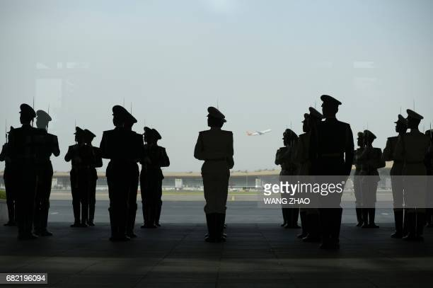 Chinese honour guards prepare for the arrival of Malaysian Prime Minister Najib Razak at Beijing Capital International Airport on May 12,2017. Najib...