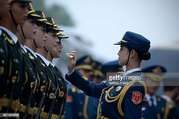 Chinese honour guards prepare for the arrival of New Zealand's Governor-General Jerry Mateparae and Chinese President Xi Jinping during a welcome...