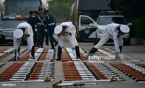 Chinese honour guards prepare for the arrival of Queen Margrethe II of Denmark and Chinese President Xi Jinping during a welcome ceremony at the...