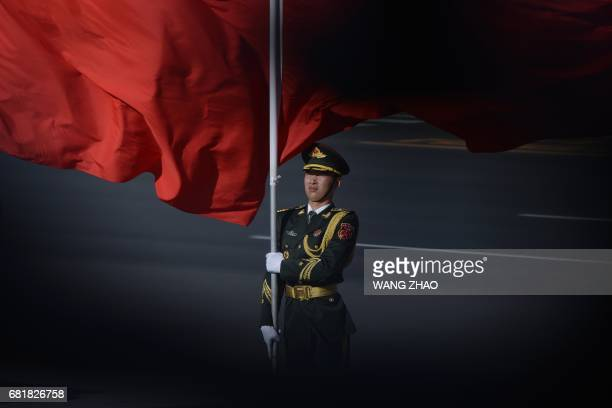 Chinese honour guards prepare for the arrival of Vietnamese President Tran Dai Quang and Chinese President Xi Jinping during a welcome ceremony at...