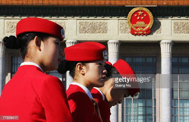 Chinese hostesses wait for the delegates in front of the Great Hall of the People during the opening session of the fiveyearly Chinese Communist...