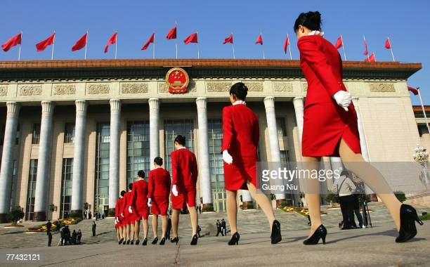 Chinese hostesses walk into the Great Hall of the People during the Chinese Communist Party Congresson on October 21, 2007 in Beijing, China. The...