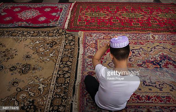 Chinese Hui Muslim adjusts his skull cap before Eid al-Fitr prayers marking the end of the holy fasting month of Ramadan at the historic Niujie...
