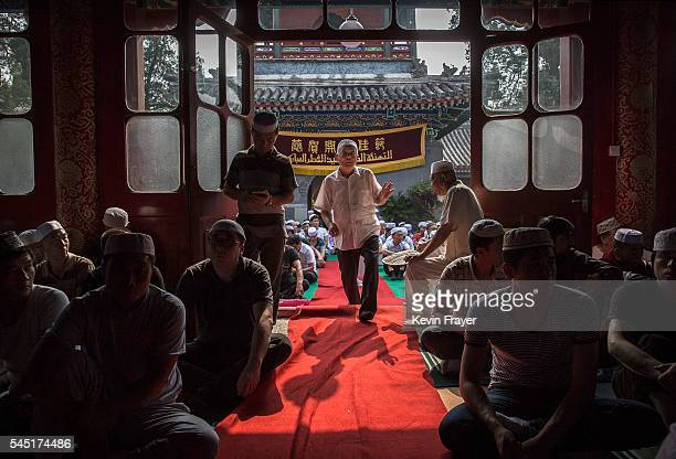 Chinese Hui Muslim man arrives for Eid al-Fitr prayers marking the end of the holy fasting month of Ramadan at the historic Niujie Mosque on July 6,...