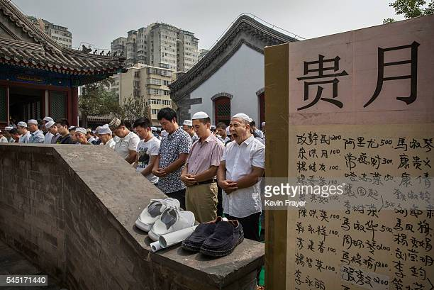 Chinese Hui Muslim man yawns as he and others gather for Eid al-Fitr prayers marking the end of the holy fasting month of Ramadan at the historic...